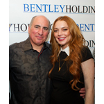 Lindsay Lohan with Cosmo DeNicola at the Futura Mobility Pre-Big Game Party at the Havana Room Cigar Club in NYC on February 1, 2014. Bentley Holdings is Cosmo DeNicola's large enterprise company. (Photo: Business Wire)