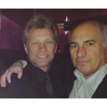 Jon Bon Jovi and Cosmo DeNicola mingle at the Ron Jaworski Celebrity Cigar Party January 30, 2014. (Photo: Business Wire)