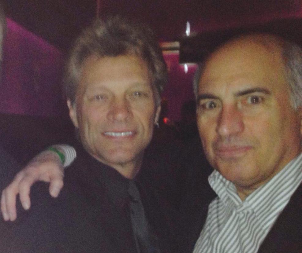 Jon Bon Jovi and Cosmo DeNicola mingle at the Ron Jaworski Celebrity Cigar Party January 30, 2014. (Photo: Business Wire)
