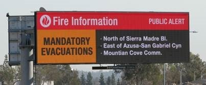 Clear Channel Outdoor digital billboard providing emergency information during the Glendora Colby fire. (Photo: Business Wire)
