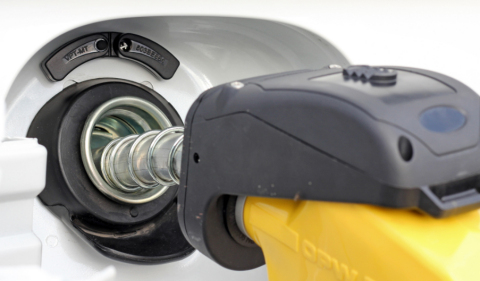 "OTI PetroSmart's half-moon shaped ""Moon Tag"", located above a car's fuel inlet, allows for an easy, fast and safe cashless transaction once connected to the Moon Tag reader. (Photo: Business Wire)"