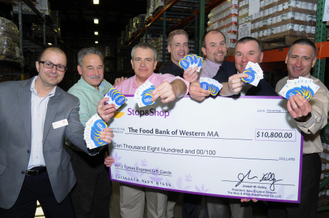 Stop & Shop store associates donate $10,800 to Andrew Morehouse (second from right), executive director of The Food Bank of Western Massachusetts in Hatfield, Mass. as part of Stop & Shop's annual Turkey Express program. Stop & Shop donated more than $2 million this holiday season to the communities it serves in the spirit of sharing meals and giving thanks. (Photo: Business Wire)