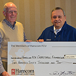 Paul Marotta, Chairman of the Board at Hanscom FCU, presents a check to Alan Hart, Chairman of the Hanscom FCU Charitable Foundation Board. The funds are the largest gift the credit union has made to date, and will be used to support causes within Hanscom FCU's member communities. (Photo: Business Wire)