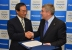 Kazuhiro Tsuga, President of Panasonic, and Thomas Bach, President of the IOC at the Signing Ceremony (Photo: Business Wire)