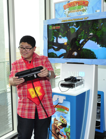 In this photo provided by Nintendo of America, Rico Rodriguez of Modern Family enjoys playing Donkey Kong Country: Tropical Freeze for Wii U at the Annenberg Beach House in Santa Monica, Calif., on Feb. 6, 2014, to celebrate the Feb. 21 launch of the latest installment of the beloved Donkey Kong franchise. In the new game, Donkey Kong and his friends take on a horde of icy invaders who are freezing their tropical island home. Donkey Kong Country: Tropical Freeze for Wii U features beautiful high-definition graphics as well as off-screen play using the Wii U GamePad.