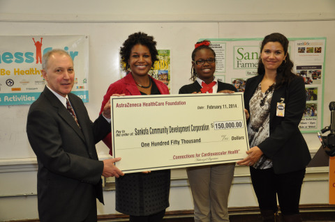 From left to right: James W. Blasetto, M.D., MPH, FACC, Chairman of the AstraZeneca HealthCare Foundation; Rashida Ferdinand, Founder and Executive Director of Sankofa Community Development Corporation; Zydikiyah Morrison, a participant in the Sankofa HEAL Project; and Daniela Rivera, Treasurer of the Board at Sankofa Community Development Corporation, at a ceremony today for the presentation of a grant for $150,000 to Sankofa Community Development Corporation from the AstraZeneca HealthCare Foundation. The event took place at ARISE Academy in New Orleans, La. The AstraZeneca HealthCare Foundation has announced grants totaling nearly $3.7 million to 19 U.S.-based nonprofit organizations across the country dedicated to improving cardiovascular health in local communities. (Photo: Business Wire)