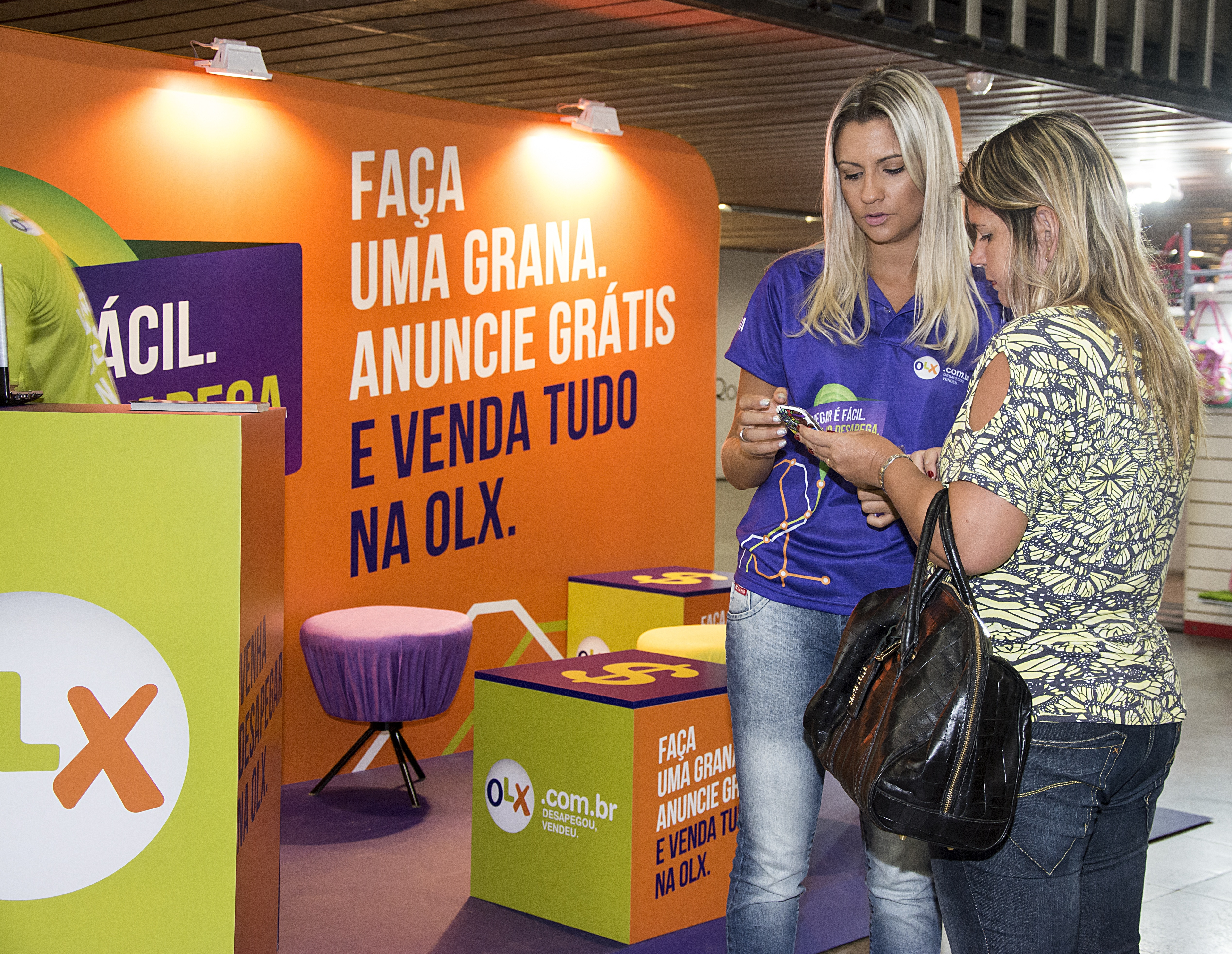 An OLX kiosk in use. (Photo: Business Wire)