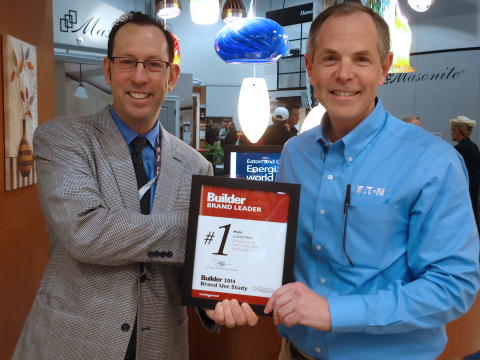 Eaton's Glenn Siegel (right) receives the Brand Leader award from Builder magazine, presented by Ed Kraft. The Halo product line has been recognized with this honor for 16 consecutive years. (Photo: Business Wire)