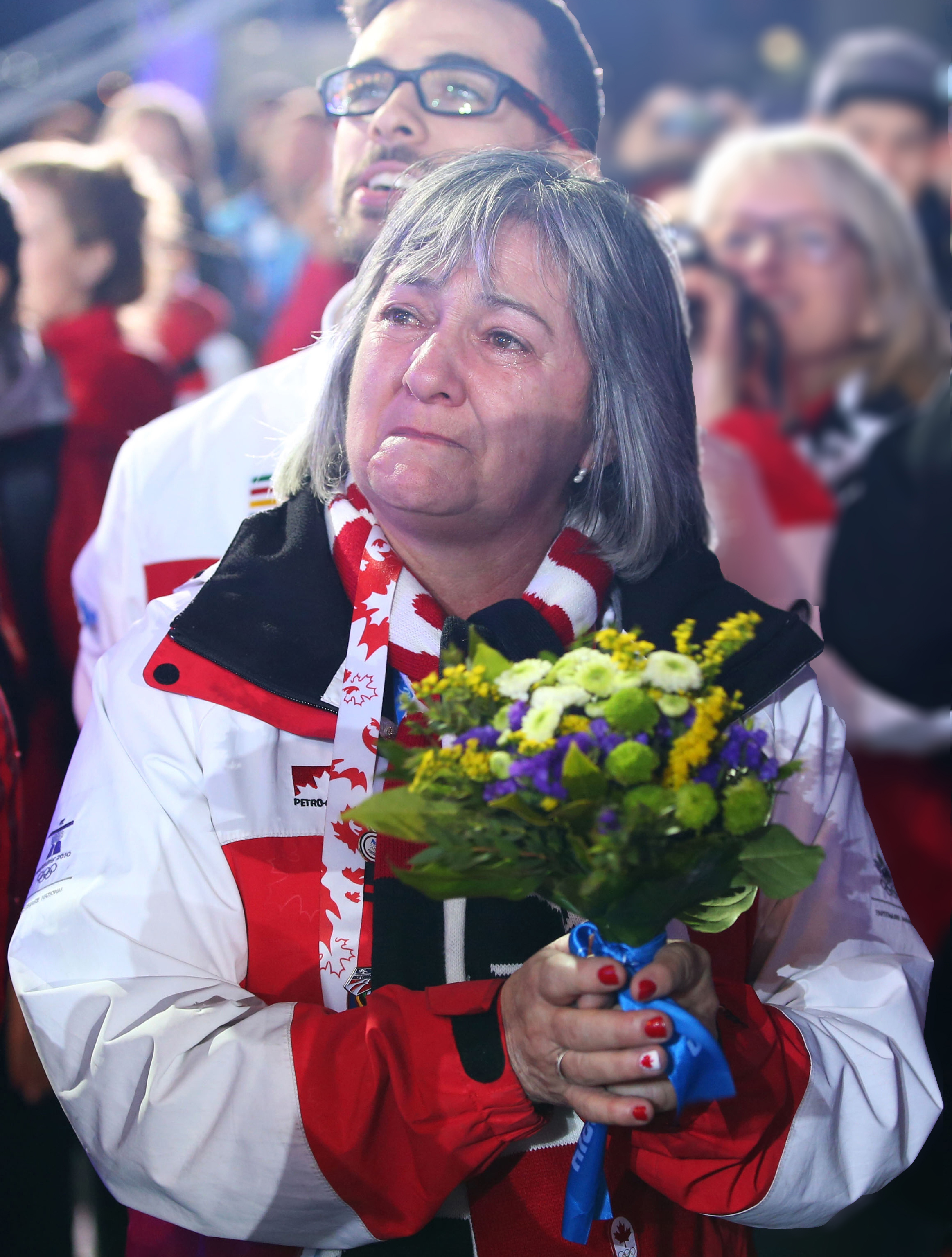 Manon Goulet, mother of short track speed skater Charles Hamelin, along with his brother, François, look on as Hamelin receives gold during the medal ceremony for the 1,500 metre in Sochi. As part of the P&G Thank You Mom campaign, the Hamelin brothers have spoken about the important role their mother has played in their journey to Sochi.
