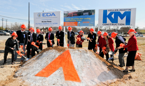 Accion Texas President and CEO Janie Barrera (wearing red, in center) is joined by board members, civic leaders and donors February 12 during the groundbreaking ceremony for the new Accion Texas Lending and Learning Center to be located at 2015 W. Martin Street on the West Side of San Antonio in the historic Prospect Hill neighborhood. The new center should open in 2015. (Photo: Business Wire)