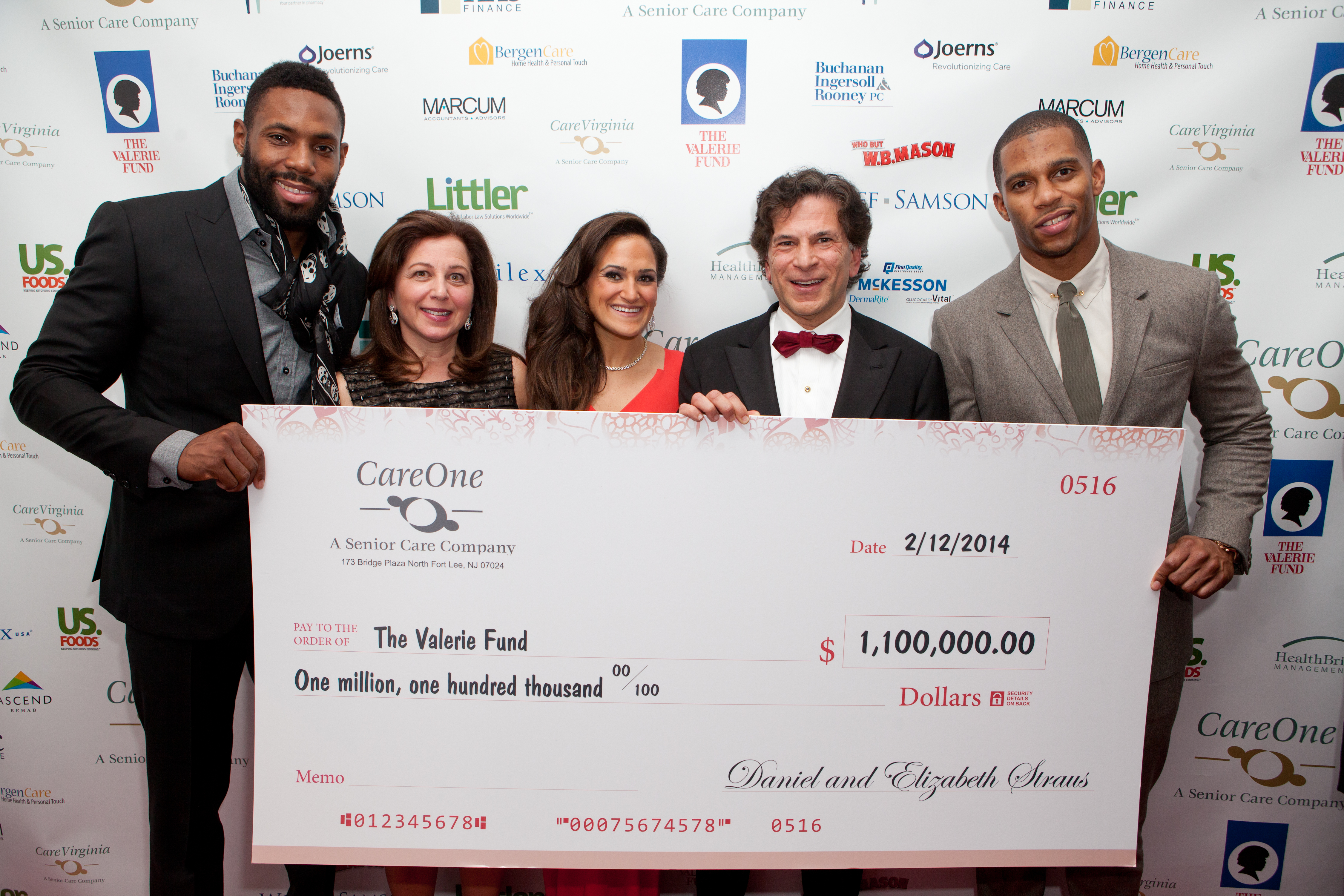 Victor Cruz of the New York Giants, and Antonio Cromartie of the New York Jets, joined Daniel E. Straus, Elizabeth Straus and Joyce Straus of CareOne. (Photo: Business Wire)