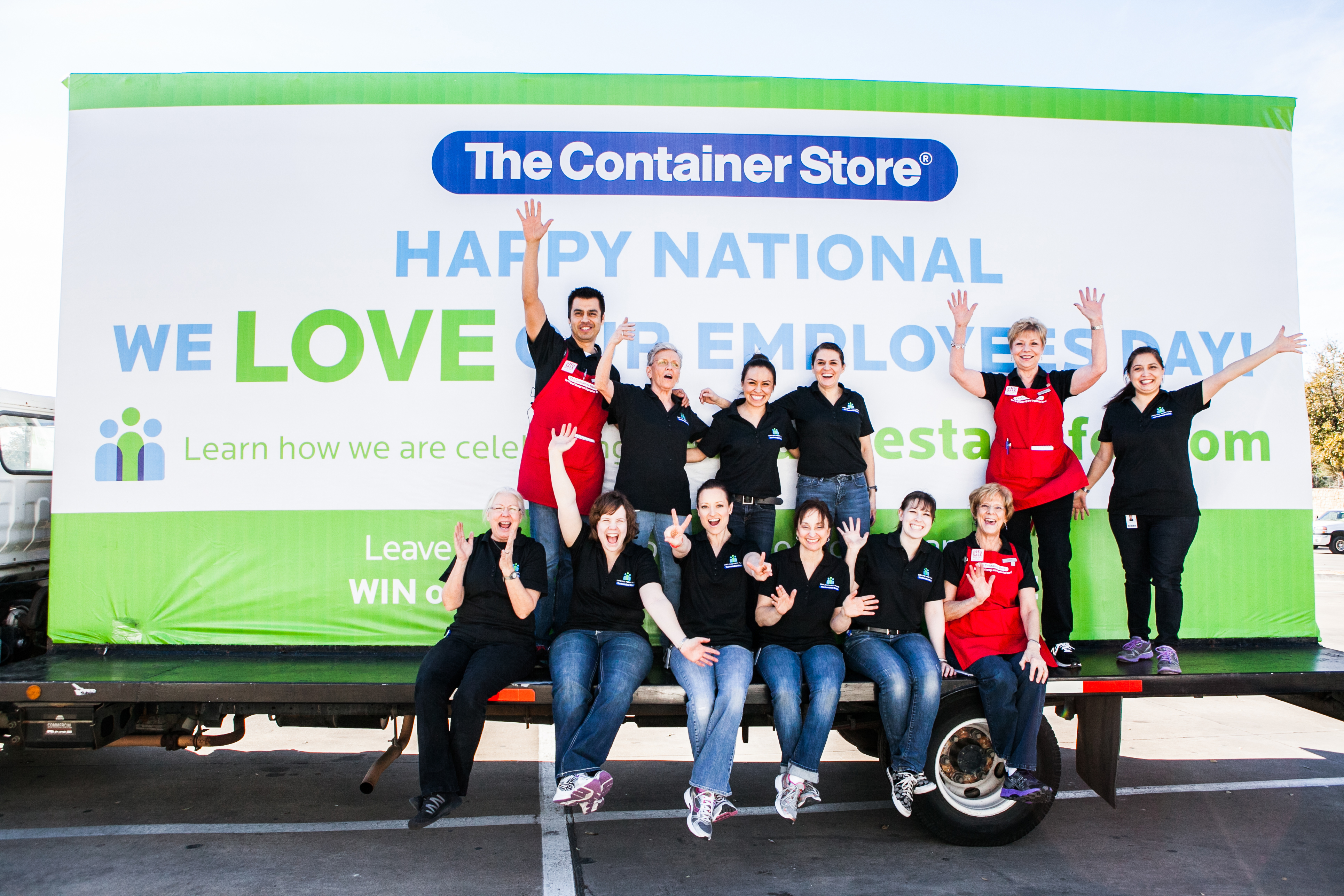 Employees at The Container Store's Fort Worth store celebrated the announcement of the retailer's Employee First Fund in front of a Mobile Billboard.  The Billboard traveled to all of the retailer's store locations in the Dallas-Fort Worth Metroplex today as well as the Home Office in Coppell. (Photo: Business Wire)