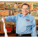 "Boston Market, led by CEO George Michel (a.k.a. ""The Big Chicken""), has significantly reduced sodium in several key menu items. (Photo: Business Wire)"