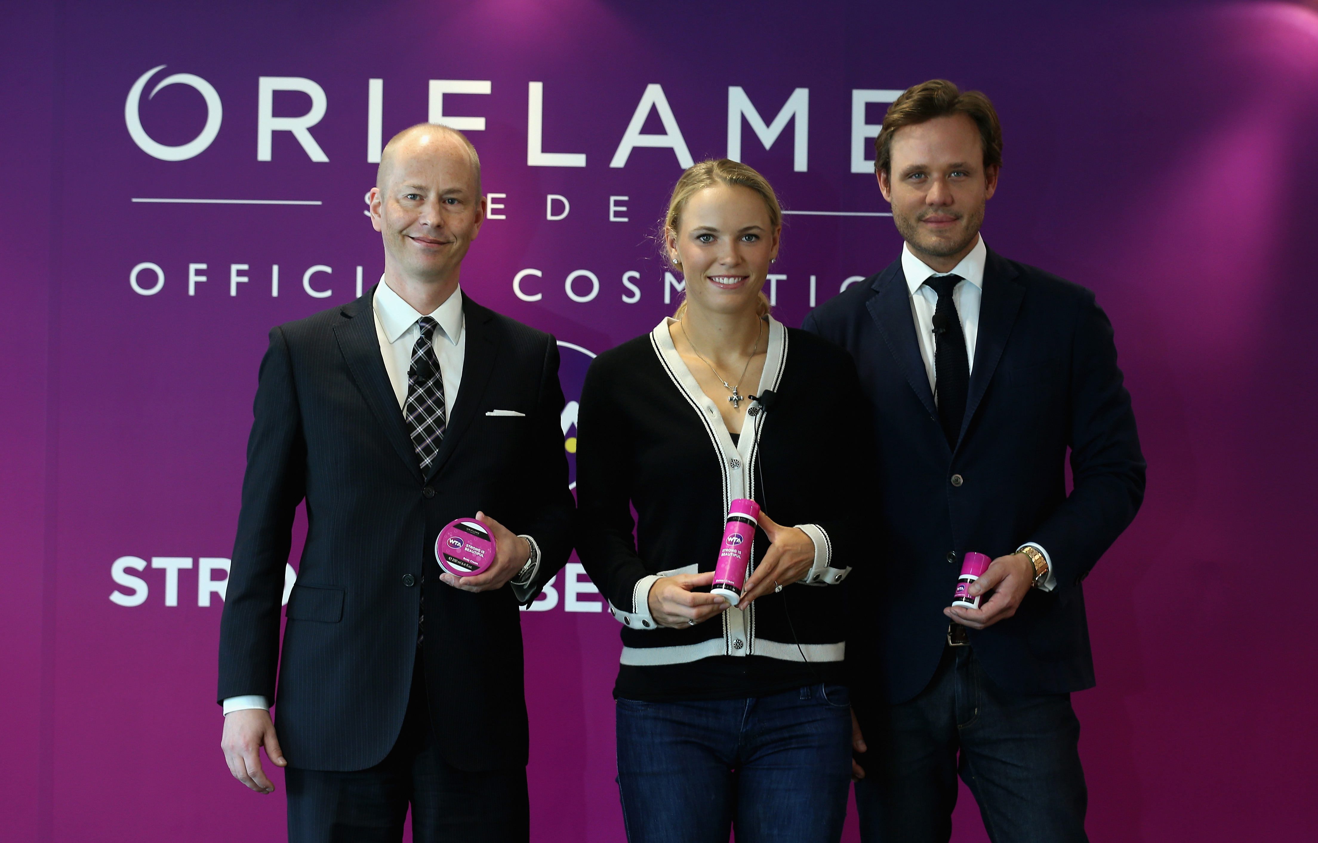 Oriflame announces the official launch of its WTA Strong is Beautiful product line with the help of Michael Cervell, Caroline Wozniacki and Jonas Wramell. (Photo: Business Wire)