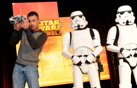 """Actor Freddie Prinze, Jr., voice of Kanan, holds Star Wars Rebels Ghost Ship, joined by Stormtroopers, as Disney Consumer Products unveils an innovative assortment of toys inspired by the upcoming animated TV series """"Star Wars Rebels,"""" Monday, Feb. 17, 2014, at the American International Toy Fair in New York. (Photo by Diane Bondareff/Invision for Disney Consumer Products)"""