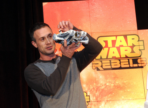 """Actor Freddie Prinze, Jr., voice of Kanan, holds Star Wars Rebels Ghost Ship, as Disney Consumer Products unveils an innovative assortment of toys inspired by the upcoming animated TV series """"Star Wars Rebels,"""" Monday, Feb. 17, 2014, at the American International Toy Fair in New York. (Photo by Diane Bondareff/Invision for Disney Consumer Products)"""