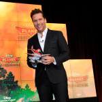 Actor Dane Cook, voice of Dusty Crophopper, holds Fire Blastin' Dusty, as Disney Consumer Products unveils an innovative assortment of toys inspired by Disney's animated film Planes: Fire & Rescue, Monday, Feb. 17, 2014, at the American International Toy Fair in New York. (Photo by Diane Bondareff/Invision for Disney Consumer Products)