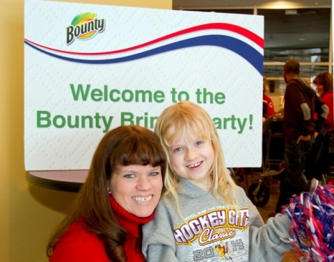 "For her participation in their ""Bring It"" campaign, Bounty paper towels surprised Molly Woll and her aspiring athlete daughter with an Ultimate Olympic Winter Games Viewing Party on February 16, 2014 in Minneapolis, MN. (Photo Credit: Andy King for AP)"