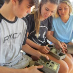 Dana Hills High School students use trapcams to study bobcat movement at the Berns Environmental Study Loop at Crystal Cove State Park, a new 'citizen science' approach funded by Crystal Cove Alliance. (Photo: Business Wire)