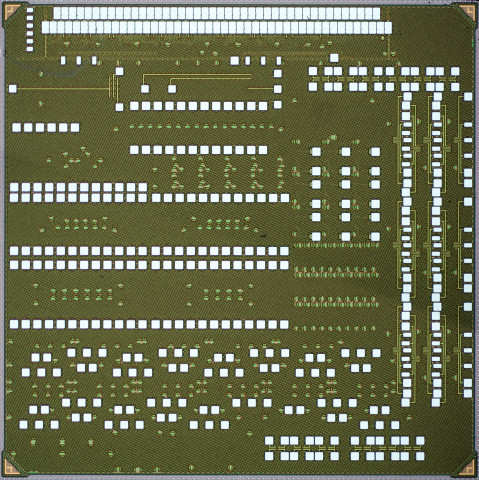 Microscope image of the full chip fabricated in IBM's 45nm process containing electronics and photonics on the same chip. Credit: Michael Georgas