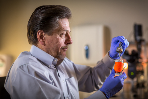 Dr. Gregory Hageman, Ph.D., examines eye tissue from a collection of more than 6,000 pairs of eyes f ...