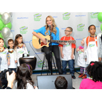 "Singer, songwriter and author Jewel, performs the ""Clean-Up Song,"" presented by Swiffer, to children during a crafting event in New York, Thursday, Feb. 20, 2014.  The ""Clean-Up Song"" will be available for free download on www.facebook.com/swiffer along with a video of the performance from the event. (Photo: Business Wire)"