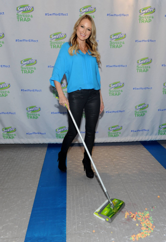 """Singer, songwriter and author Jewel cleans up with the new Swiffer Sweep & Trap during a children's crafting event in New York, Thursday, Feb. 20, 2014.  Jewel also premiered the """"Clean-Up Song,"""" presented by Swiffer which will be available for free download on www.facebook.com/swiffer, along with the video of her performance at the event. (Photo: Business Wire)"""