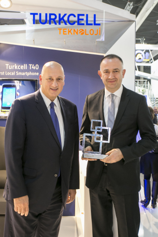 Turkcell CEO Sureyya Ciliv and Chief Consumer Marketing Officer Burak Sevilengul celebrated My Dream Partner's Global Mobile Award at Turkcell's Mobile World Congress booth. (Photo: Business Wire)