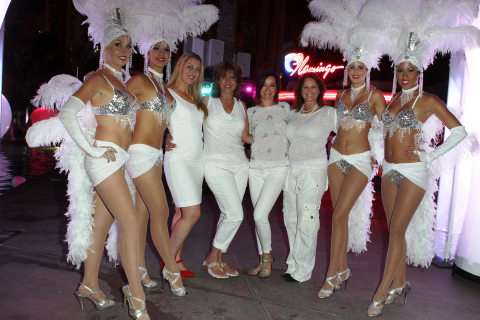 Dinah Vegas returns to Sin City for its third year in association with Total Rewards by Caesars Entertainment. Flanked by Vegas Showgirls are event producers (L-R) Linda Fusco, Sandy Sachs, Michelle Agnew and Dr. Robin Gans. (Photo: Business Wire)