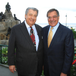 Ted Balestreri, CEO, Cannery Row Company and Secretary Leon Panetta celebrate the dedication of the Cannery Row Monument featuring John Steinbeck, Ed Ricketts and the colorful characters reminiscent of the historical Cannery Row. (Photo: Business Wire)