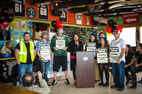 Sara Berns, Executive Director of Discover Pacific Beach, unveils the long awaited designated driver parking signs that will soon be spotted around Pacific Beach. (Photo: Business Wire)