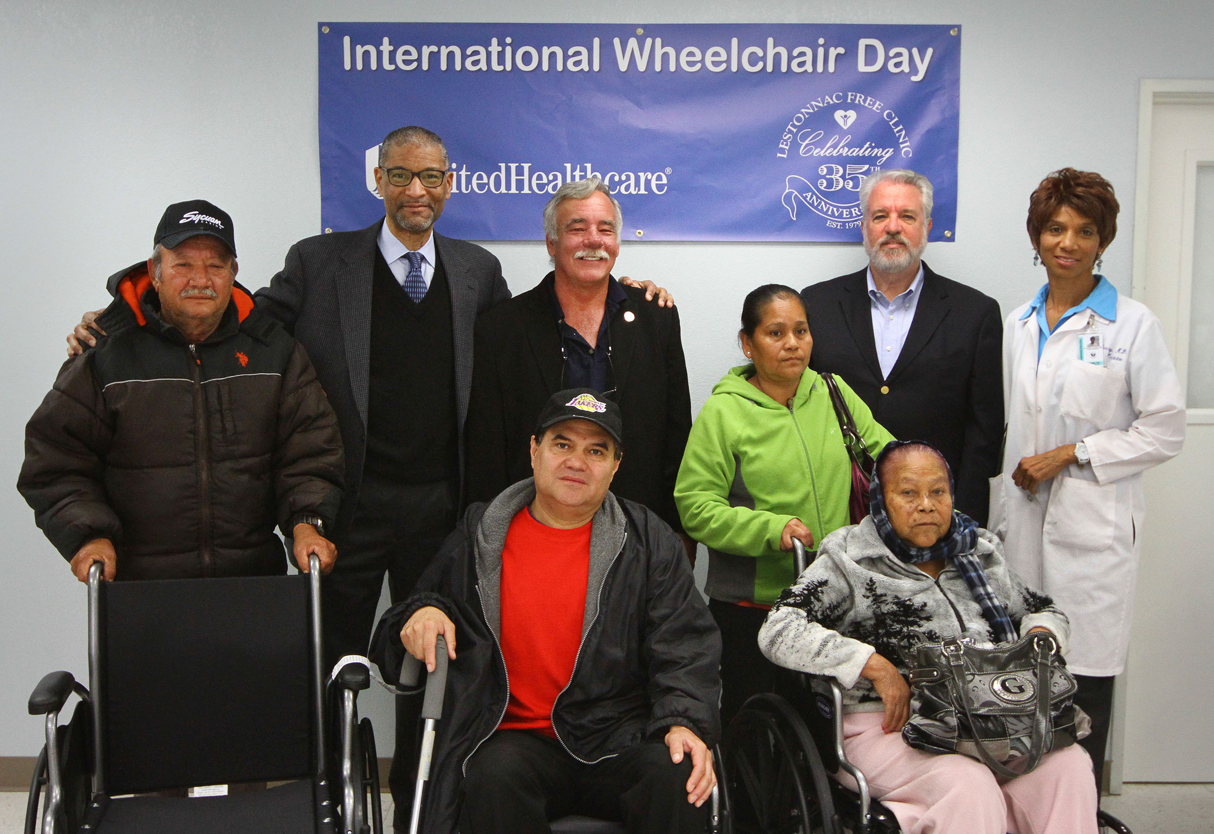 In honor of International Wheelchair Day, UnitedHealthcare on Friday, Feb. 28, donated 10 wheelchairs to Lestonnac Free Clinic's patients at the Orange clinic. Sitting in wheelchairs left to right: Antonio Alcala, 53, of Anaheim, and Antonia Palacios, 68, of Santa Ana. Standing left to right: Belizario Garcia of Santa Ana, who received the wheelchair on behalf of his wife Elizabeth Penaloza; Keith Emmons, M.D., market medical director, UnitedHealthcare; Ed Gerber, executive director of Lestonnac; Maria Chamu, daughter of Palacios; Russ Bennett, vice president, Latino Health Solutions, UnitedHealthcare; and Andrea Avery, M.D., Lestonnac board member and volunteer physician (Photo: Jamie Rector).
