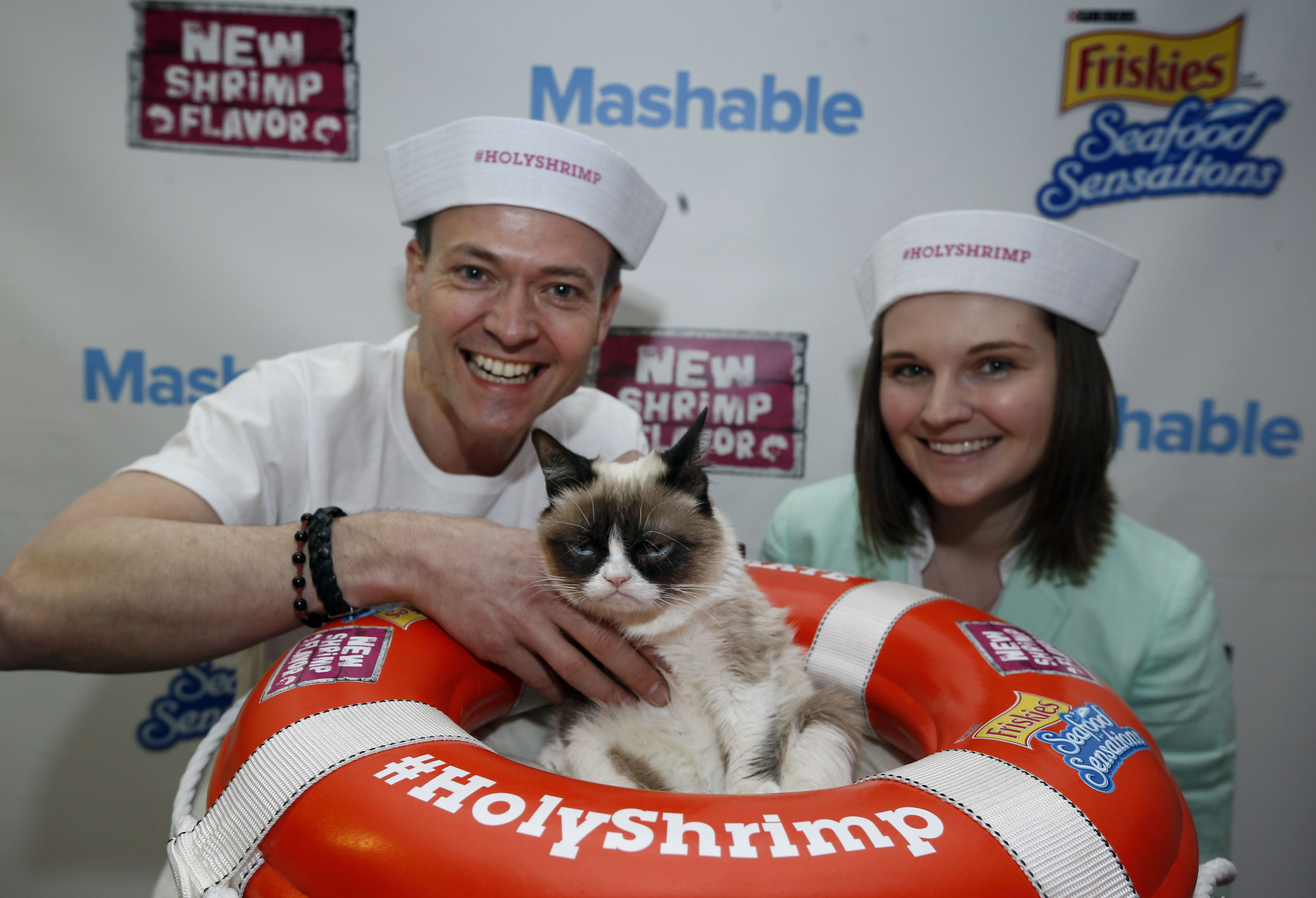 """Friskies' """"Official Spokescat,"""" Grumpy Cat, takes time to frown with fans at her sea-faring photo booth at the Mashable House on Friday, March 7, 2014. Friskies donated 25,000 meals of Friskies Seafood Sensations with NEW shrimp flavor to Friends of Austin Animal Center, and fans can help increase the donation up to 50,000 meals by posting a photo of Grumpy Cat or their own cat in social media using the hashtag #HolyShrimp between March 7-9. (Erich Schlegel/AP Images for Friskies)"""