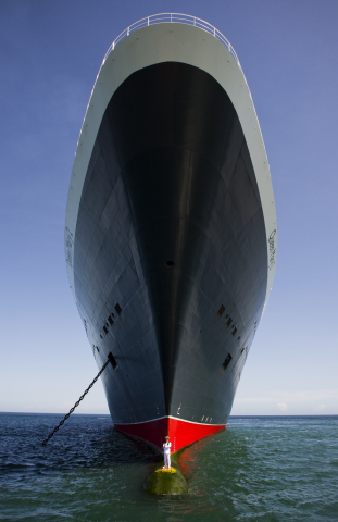 Cunard Captures Dramatic Images of Captain Standing Beneath Soaring Hull of Queen Mary 2 (Photo cred ...