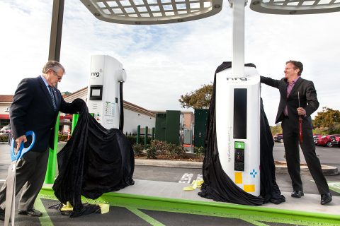 Mayor Matt Hall from the City of Carlsbad and Terry O'Day, Vice President of NRG eVgo California, display the brand new Freedom Station for charging electric cars at Carlsbad Premium Outlets in California (Photo: Business Wire)