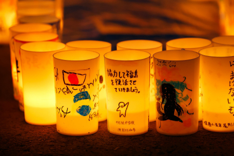 """Let's work together to revitalize Fukushima"" - A scene at ""Candle Night: Lights of Hope"" (Photo: Business Wire)"