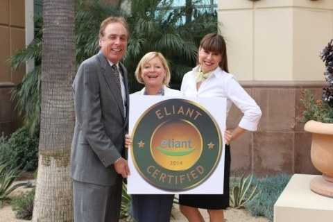 Robert Mirman awards Eliant certification to Crummack Huseby, Inc. Sandra Huseby and Margo Crummack accept on behalf of their firm. (Photo: Business Wire)