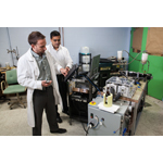 Lead Engineer Michael Benedict (left) and Venkat Venkatakrishnan (right), Director of Advanced Technologies, work in GE Appliances' labs on magnetocaloric refrigeration technology that can replace traditional compressors used in refrigerators for the last 100 years. (Photo: GE)