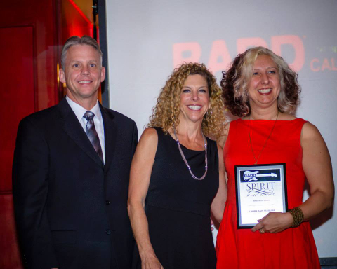 Timothy Gorsuch - (Alcoholic Beverage Control), Marian Novak - (Responsible Hospitality Coalition) present Laura Ann Masura (RADD NEHA Co-Chair) with a RADD Spirit Award for her dedication and support. (Photo: Business Wire)