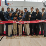 New York City's YMCA CEO Jack Lund cuts the ribbon on the new Rockaway YMCA at Arverne by the Sea with community leaders and kids from P.S. 197 (Photo: Business Wire)
