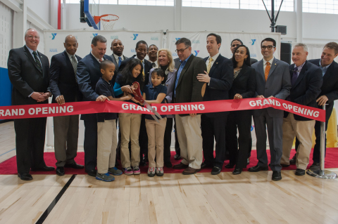 New York City's YMCA CEO Jack Lund cuts the ribbon on the new Rockaway YMCA at Arverne by the Sea wi ...