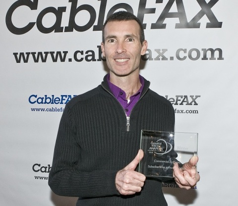 SubscriberWise president David E. Howe proudly displays award at Yale Club in New York City (Photo: Business Wire)