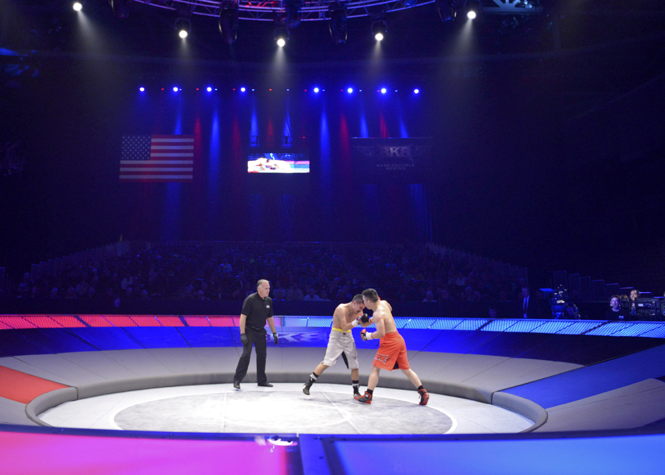 """Big-Knockout Boxing (BKB), developed and owned by DIRECTV, is an aggressive new sport, matching up two fighters who face off in """"The Pit,"""" a smaller fighting surface that forces more pound-for-pound action than traditional boxing. The sport has now been sanctioned by the Nevada State Athletic Commission. (Photo: Business Wire)"""