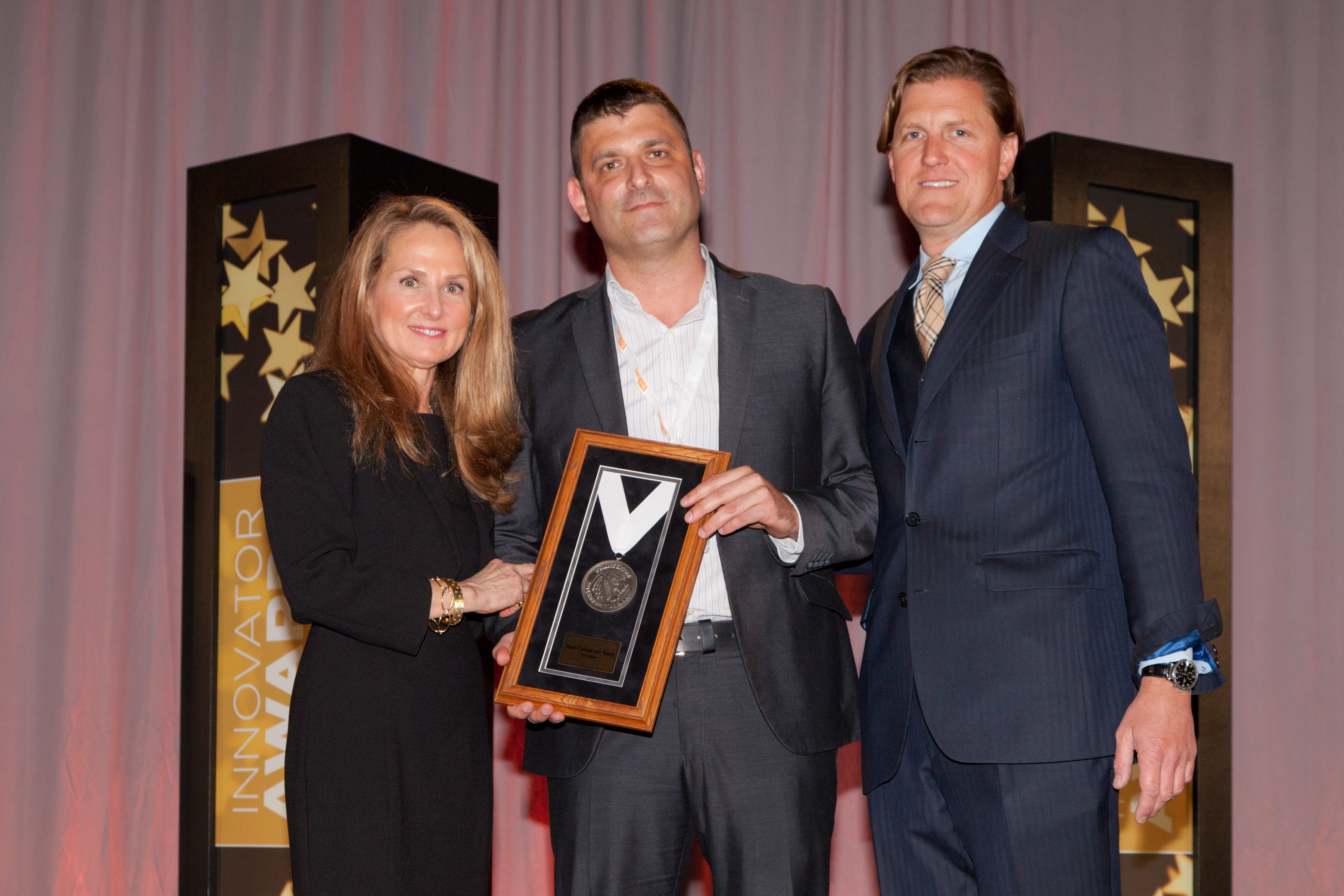 """Presenting a 2014 award for """"Best Comeback Story"""" to Shlomi Eytan (center), oti global vice president of sales and marketing, is Karen Webster (left) founder and President of PYMNTS.com, and Tim Attinger (right), Strategy, Corporate Development and Digital Innovation for Blackhawk Network. oti is a global provider of NFC and cashless payment solutions. Photo courtesy of Richard Pasley."""