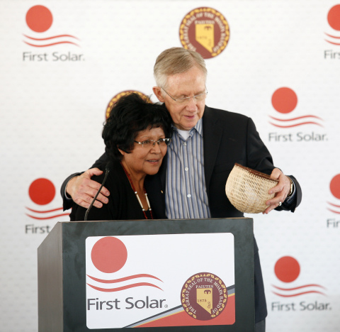 Aletha Tom, Chairwoman of the Moapa Band of Paiutes, presents US Senate Majority Leader Harry Reid with a basket as a gift for his support of the Moapa Southern Paiute Solar Project. (Photo: Business Wire)