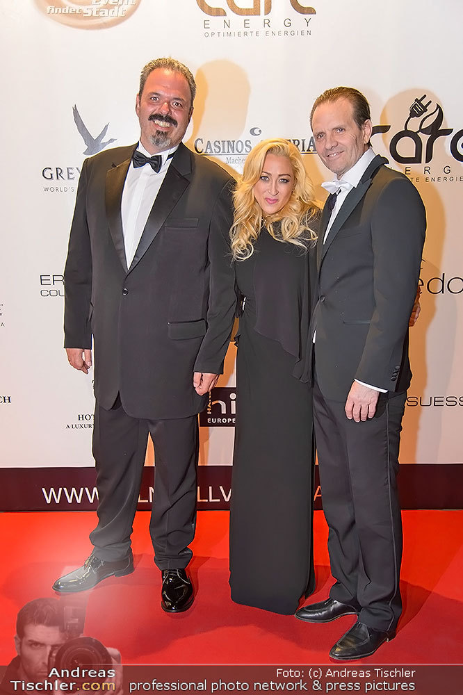 Martin Kristek of Care Energy with Jennifer Blanc Biehn and Michael Biehn hosting them as they get their award from the Vienna Film Ball (Photo: Business Wire)