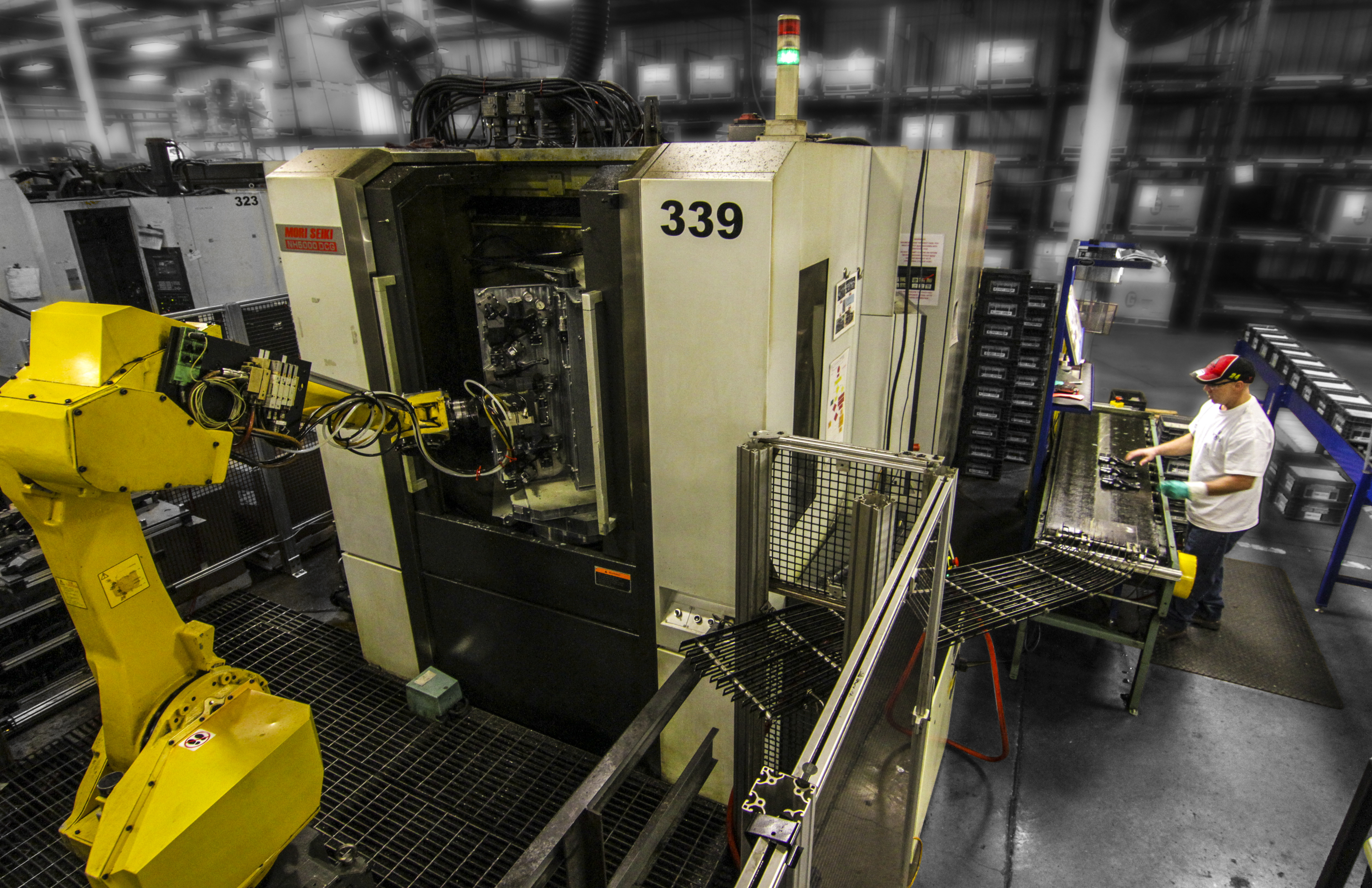 Vickers Engineering uses FANUC industrial robots for a variety of machine tending operations. (Photo: Business Wire)