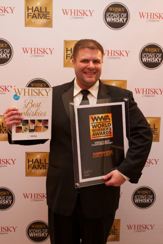 "Sons of Liberty Founder Mike Reppucci seen here at Whiskey Magazine's World Whiskies Awards in London for winning a ""World's Best"" award in the Best Flavored Whiskey category for their Pumpkin Spice. (Photo: Business Wire)"