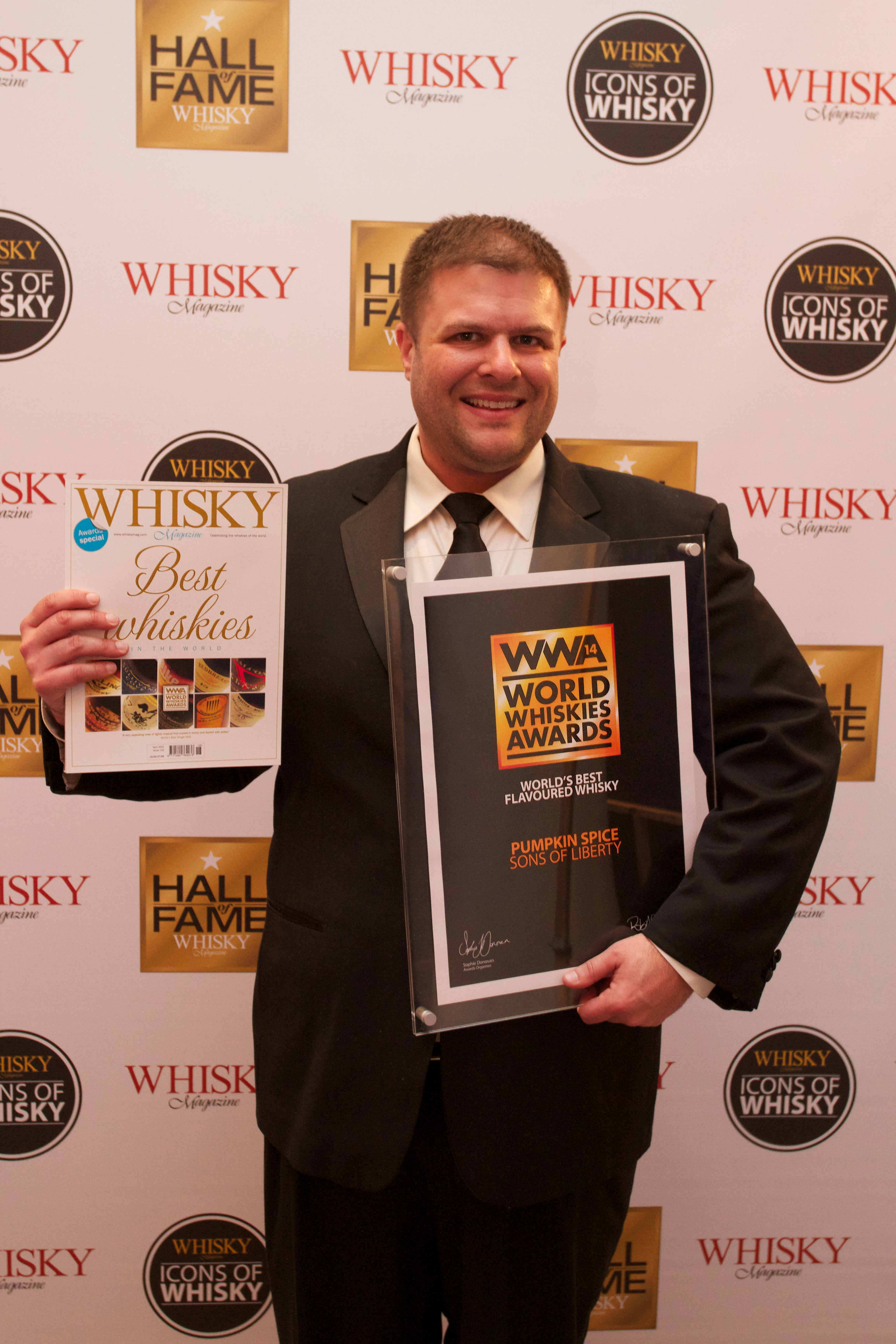 """Sons of Liberty Founder Mike Reppucci seen here at Whiskey Magazine's World Whiskies Awards in London for winning a """"World's Best"""" award in the Best Flavored Whiskey category for their Pumpkin Spice. (Photo: Business Wire)"""