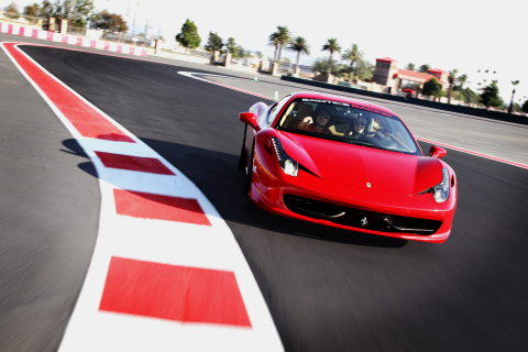 A Ferrari 458 Italia from Exotics Racing drives around the new track at Auto Club Speedway (Photo: Business Wire)